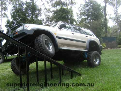 Nissan Patrol flexing on a ramp to get measurements