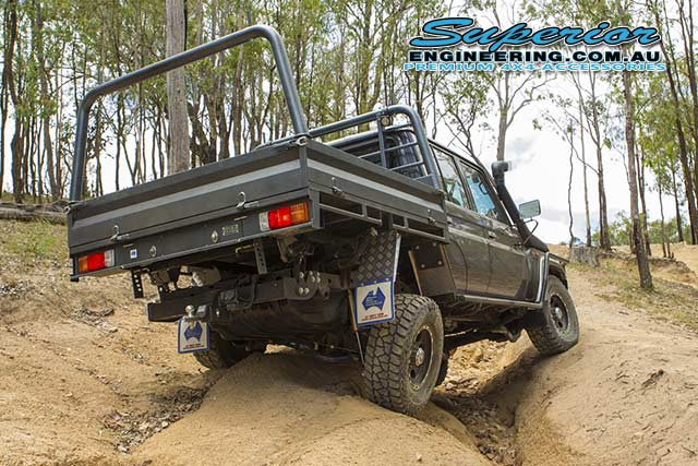 Rear right end view of the 79 Series Toyota Landcruiser testing out the rear flex on the coil conversion