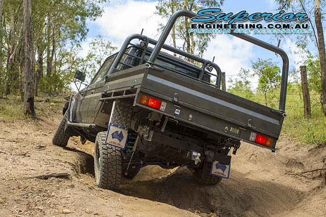 Rear end view of the 79 Series Toyota Landcruiser testing out the rear coil conversion flex at Landcruiser Mountain Park