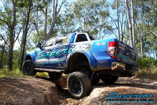 Side left angle view of the Ford PXII Ranger with the rear coil conversion flexed out offroading