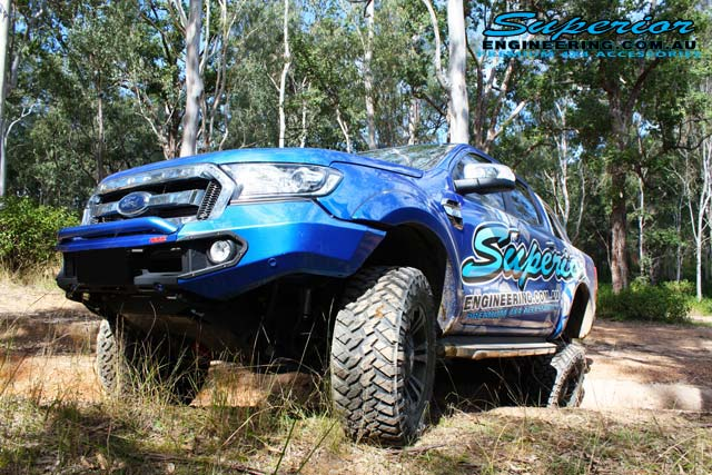 Front left angle view of the Ford PXII Ranger with the rear coil conversion fitted flexing out offroad