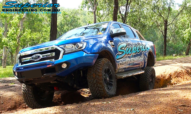 Front angle view of the Ford PXII Ranger with the rear right coil suspension flexed out offroading