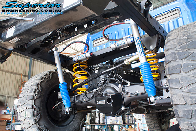 Rear right underbody view of the Ford PXII Ranger with the rear coil conversion fitted showing all products whilst on the hoist