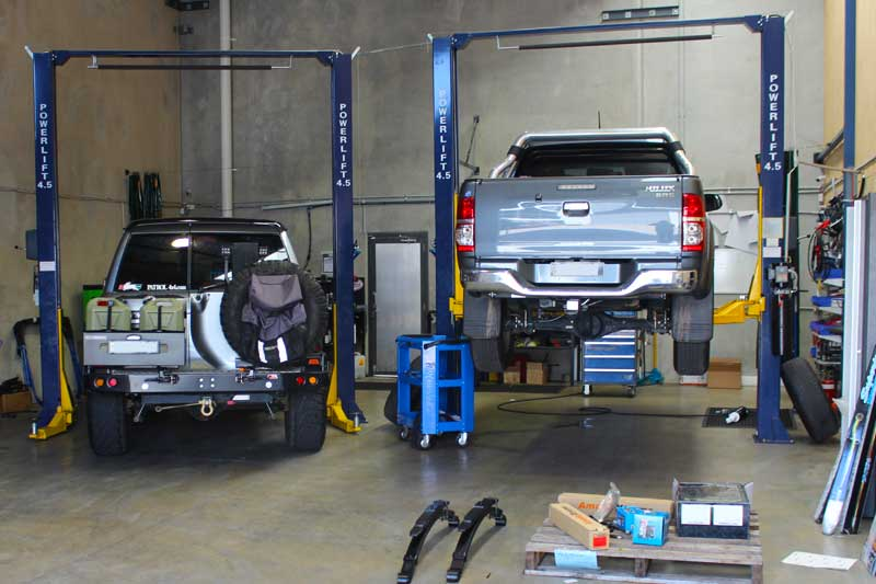 Vehicle fitting bay with 2 vehicles on the hoist at Deception Bay workshop