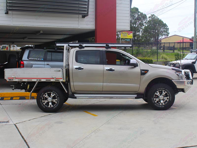 Right side view of a gold Ford Ranger dual cab fitted with a 2 inch Bilstein lift kit