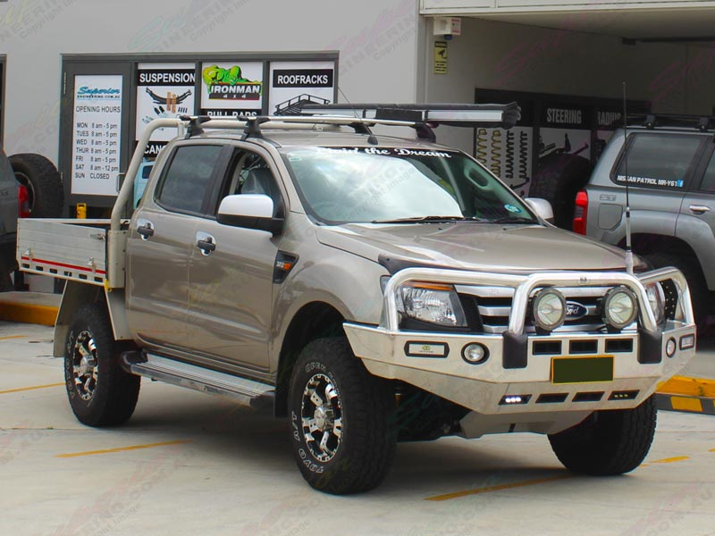 Front right view of a gold Ford Ranger dual cab fitted with a 2 inch Bilstein lift kit