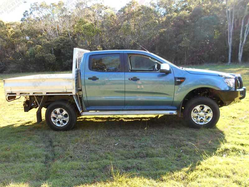 Side view of a blue Ford Ranger (Series 2) dual cab after being fitted with a stage 2 40mm Tough Dog lift kit