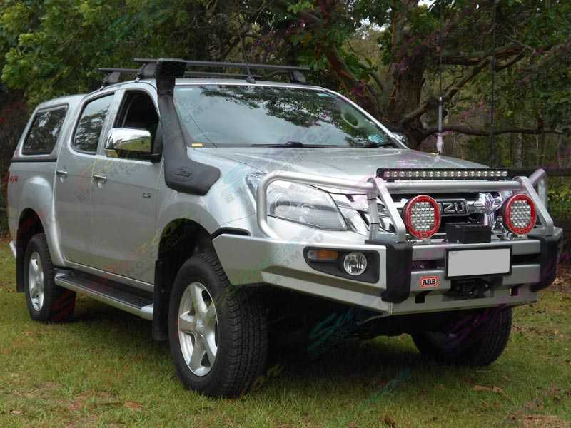 Right front side photos of a silver Isuzu Dmax fitted with a Superior 2 inch nitro gas lift kit