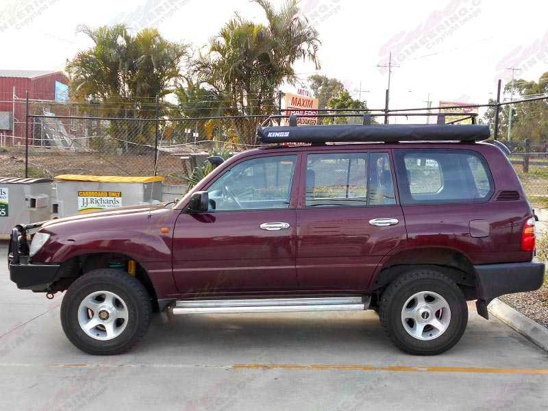 Left Side View Of A Maroon Toyota Landcruiser 105 Series After Being Fitted With A Dobinson