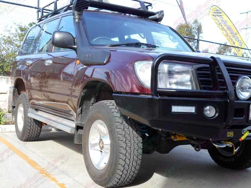 Front right side view of a Landcruiser 105 Series after being fitted with a heavy duty Dobinson 2 inch lift kit