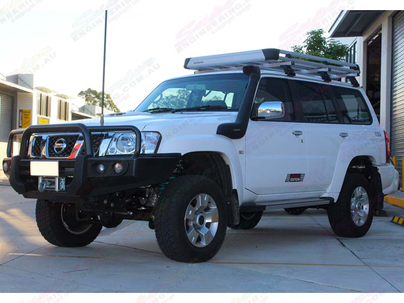 Front left view of a white Nissan Patrol GU Wagon fitted with a 2 inch Superior Remote Res lift kit