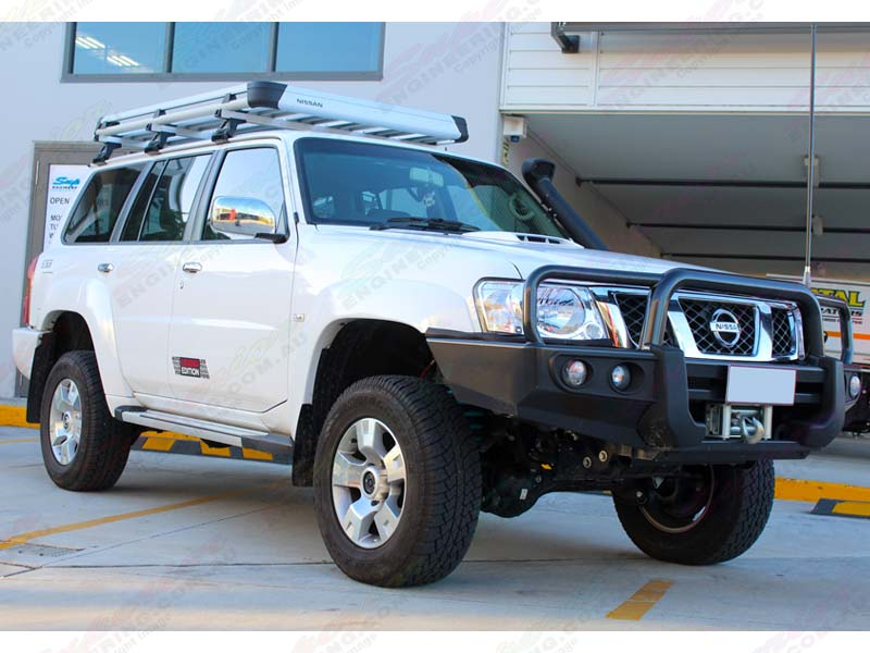 Front right view of a white Nissan Patrol GU Wagon fitted with a 2 inch Superior Remote Res lift kit