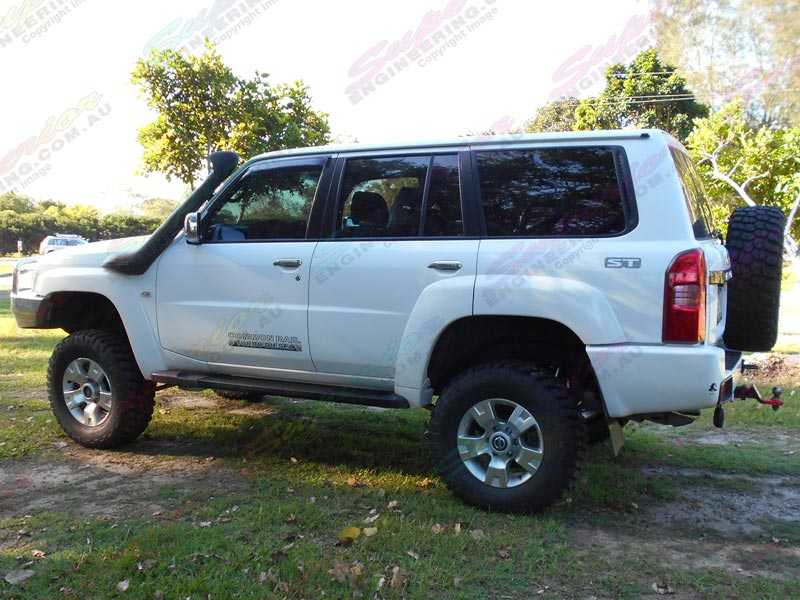 Left side view of a Superior Remote Res Superflex 4 Inch Lift Kit for a Nissan Patrol