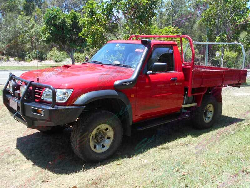 Red Nissan Patrol GU Single Cab Ute fitted with Superior 2 inch nitro gas lift kit