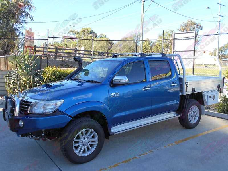 Left Side View Of Blue Hilux With Aluminium Tray After Fitted With A 2 Inch Bilstein