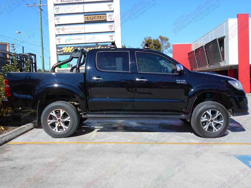 Ride Side View Of A Black Toyota Hilux Dual Cab Fitted With A 3 Inch Bilstein