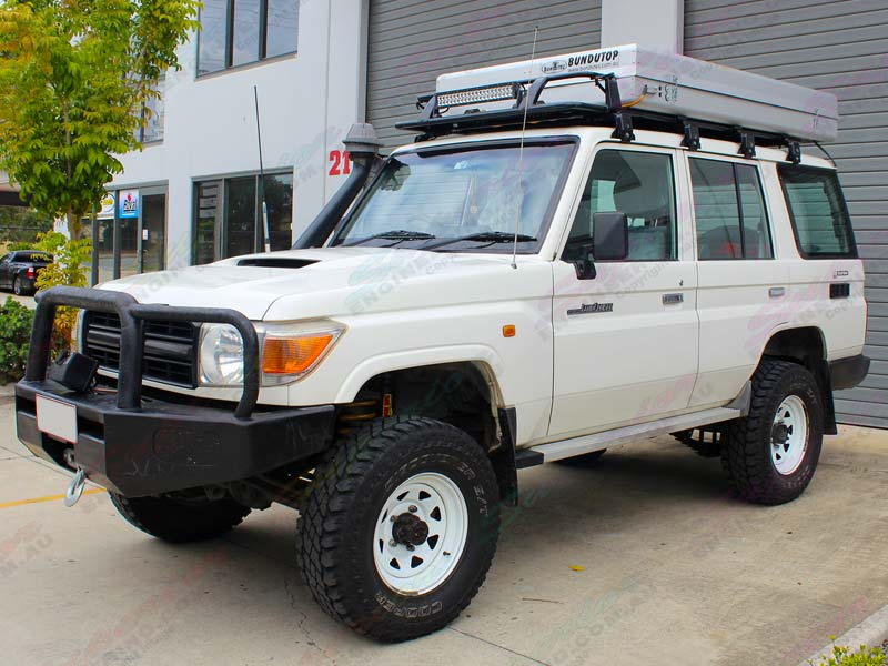 Left Front Side View Of A White Toyota Landcruiser 76 Series Fitted With A Tough Dog