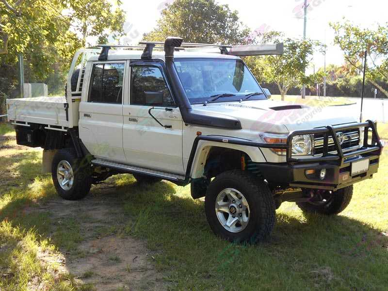 Right side view of the fitted Superior 4 Inch Lift Kit on the Toyota Landcruiser 78/79 Series V8
